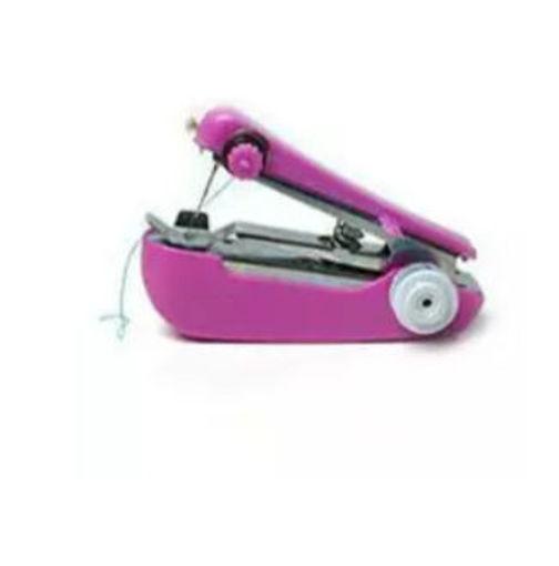 صورة مكينة خياطة يدوية صغيرة
